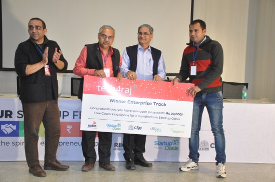 (Left to Right) COO, Startup Oasis, Mr Chintan Bakshi, Mr Anoop Mathur, DGM, RIICO; Chief General Manager, Mr Anil Sharma giving away the first prize under the Enterprise Category to Mr. Mangilal Godara of Rural Ally