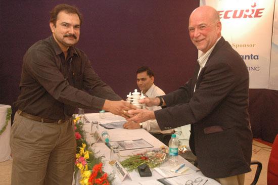 Mr. Naveen Choudhary presenting a souvenir to Prof. Sorel Reisman | ETNCC 2011